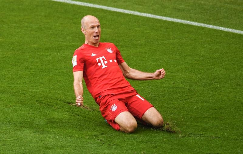 Arjen Robben scored in his final home game as Bayern Munich won a seventh straight title on Saturday