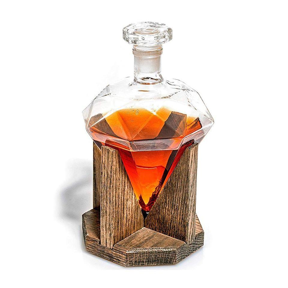 """<p><strong>Prestige Decanters</strong></p><p>amazon.com</p><p><strong>$140.00</strong></p><p><a href=""""https://www.amazon.com/dp/B017TFY14Y?tag=syn-yahoo-20&ascsubtag=%5Bartid%7C2089.g.3171%5Bsrc%7Cyahoo-us"""" rel=""""nofollow noopener"""" target=""""_blank"""" data-ylk=""""slk:Shop Now"""" class=""""link rapid-noclick-resp"""">Shop Now</a></p><p>This sleek and stylish glass decanter and wood base from Prestige Decanters certainly gets points for presentation, but it's also a highly functional and practical gift set for anyone who appreciates sipping their whiskey at the perfect temperature.</p>"""