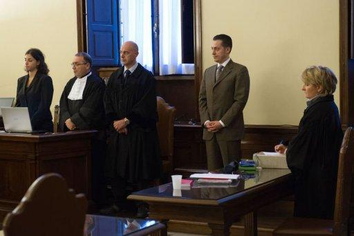 <p>Pope Benedict's former butler Paolo Gabriele (L) listens to the verdict during his trial at the Vatican on October 6, 2012. The pope pardoned his former butler Paolo Gabriele who was sentenced to 18 months in prison for stealing secret papal memos, but banished the once loyal servant from the Vatican forever.</p>