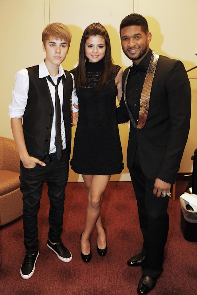 """Teen pop couple Justin Bieber and Selena Gomez mingled with R&B superstar Usher backstage at the 33rd Annual Georgia Music Hall Of Fame Awards in Atlanta on Saturday night. """"Honoring my friend and teacher @atlvox tonight,"""" Justin tweeted, referring to his vocal coach, music producer Jan Smith, who received the evening's Chariman's Award. Rick Diamond/<a href=""""http://www.gettyimages.com/"""" target=""""new"""">GettyImages.com</a> - September 17, 2011"""