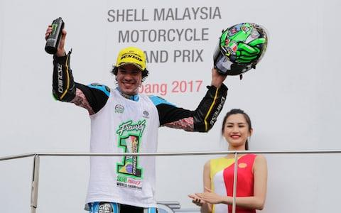 epa06296380 World Champion 2017 Moto2, Italian Moto2 rider Franco Morbidelli of EG 0,0 Marc VDS reacts on the podium after the 2017 Malaysian Motorcycling Grand Prix at Sepang International Circuit, outside Kuala Lumpur, Malaysia, 29 October 2017. EPA/FAZRY ISMAIL  - Credit: FAZRY ISMAIL /EPA