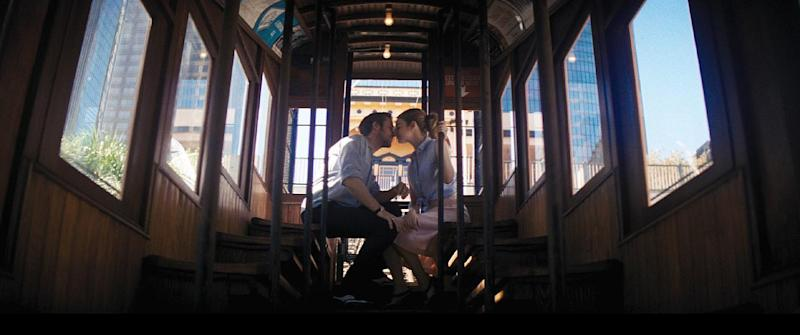 "In this undated photo from the Oscar-winning film ""La La Land"" provided by Lionsgate, actors Ryan Gosling and Emma Stone kiss aboard a railcar on Angels Flight, a tiny railroad in downtown Los Angeles, that has been shut down since 2013. Los Angeles officials announced on Wednesday, March 1, 2017, that the antique railroad should be back in service by Labor Day. (Courtesy of Lionsgate via AP)"