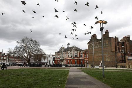 Pigeons flay over Windrush Square in the Brixton district of London, Britain April 16, 2018. REUTERS/Simon Dawson