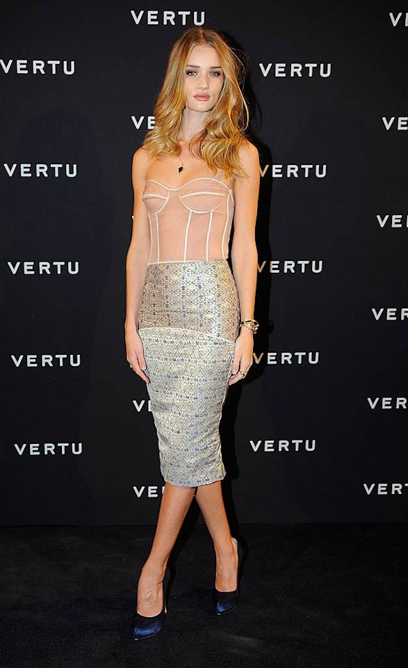 """Transformers: Dark of the Moon"" star Rosie Huntington-Whiteley is a flawless beauty, but the outfit she wore to the Vertu smartphone launch in Italy was far from fabulous. The top portion of her Richard Nicoll dress -- a peach-colored bustier -- completely clashed with the bottom half, a two-tone, printed skirt. And those navy Ferragamo pumps didn't help matters. (10/18/11)"