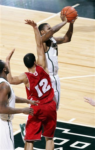 Michigan State's Keith Appling, right, shoots against Wisconsin's Traevon Jackson (12) during the first half of an NCAA college basketball game, Thursday, March 7, 2013, in East Lansing, Mich. (AP Photo/Al Goldis)