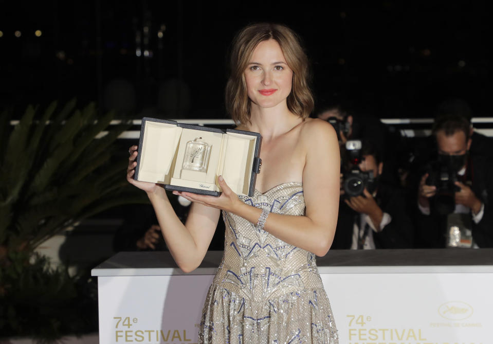 Renate Reinsve, winner of the award for best actress for the film 'The Worst Person in The World', poses for photographers during the awards ceremony at the 74th international film festival, Cannes, southern France, Saturday, July 17, 2021. (Photo by Vianney Le Caer/Invision/AP)