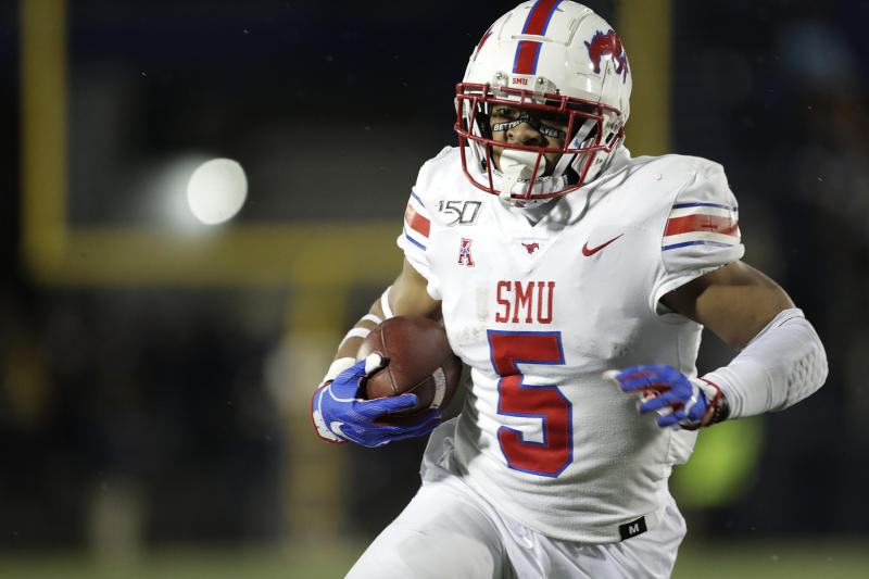SMU running back Xavier Jones runs with the ball against Navy during the first half of an NCAA college football game, Saturday, Nov. 23, 2019, in Annapolis, Md. (AP Photo/Julio Cortez)