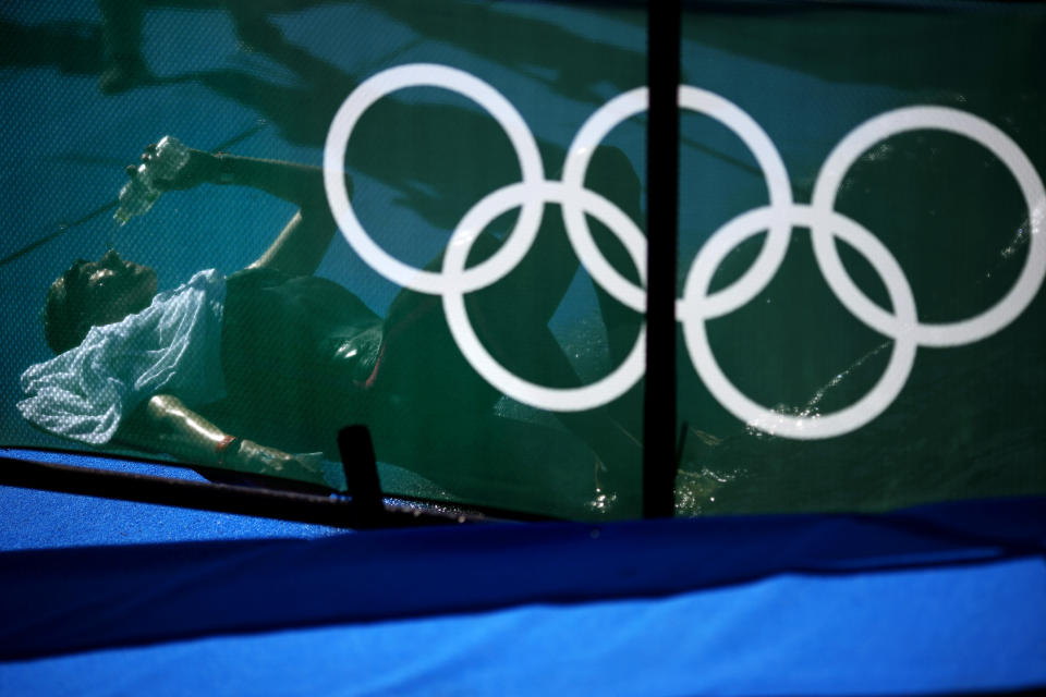 Florian Wellbrock, of Germany, pours water on his face after winning the men's marathon swimming event at the 2020 Summer Olympics, Thursday, Aug. 5, 2021, in Tokyo. (AP Photo/David Goldman)