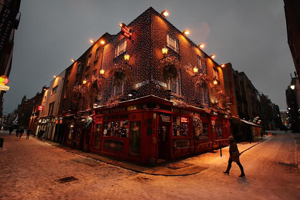 The Temple Bar pub in Dublin is swathed in Christmas decorations  (Getty Images)