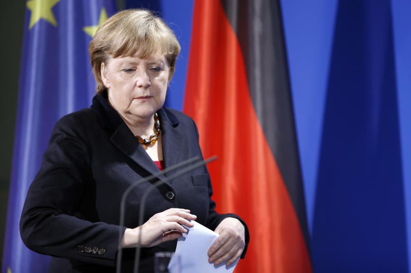 """German Chancellor Angela Merkel arrives for a statement at the chancellery in Berlin, Germany, Monday, Feb. 11, 2013. Merkel says she has the """"very highest respect"""" for German-born Pope Benedict XVI's decision to step down. Further she told reporters after the pontiff's announcement: """"As chancellor, I thank Benedict XVI for his work and wish him from the bottom of my heart all the best for the coming years."""" (AP Photo/Michael Sohn)"""