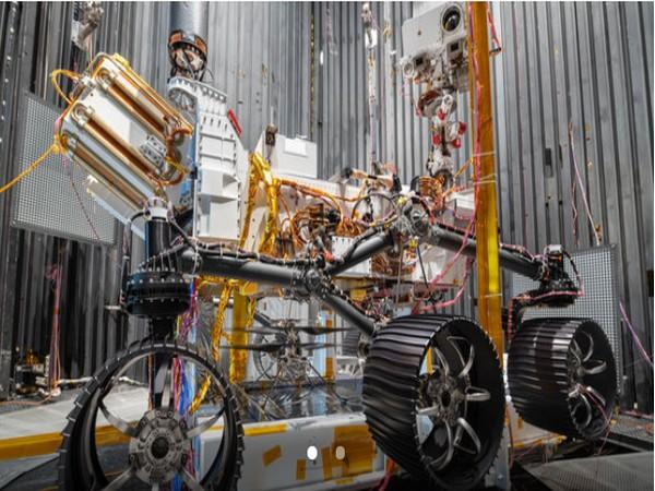 The Ingenuity Mars Helicopter can be seen between the left and center wheels of the Mars 2020 Perseverance rover (Image source: NASA/JPL-Caltech)