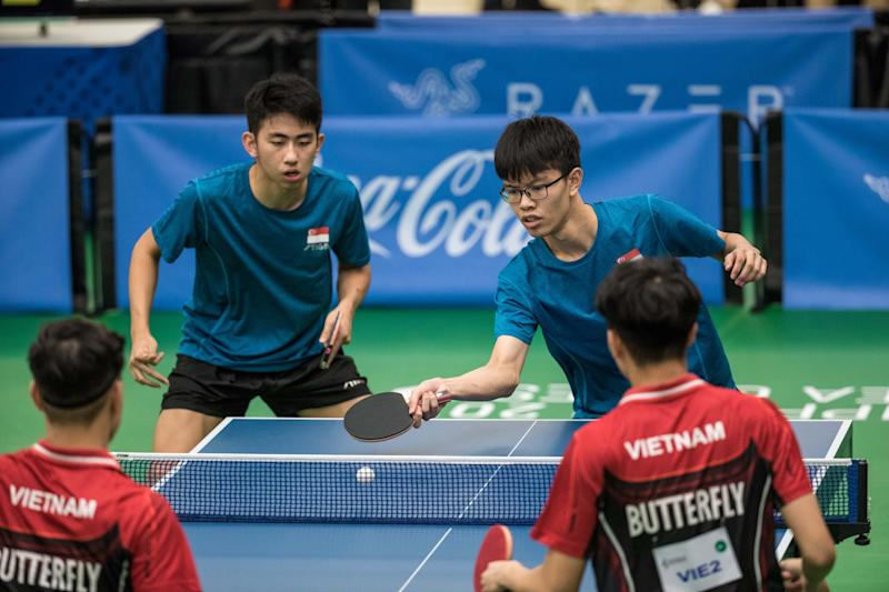 Singapore table tennis players Koen Pang (left) and Josh Chua clinched a silver in the men's doubles at the SEA Games. (PHOTO: Sport Singapore / Dyan Tjhia)