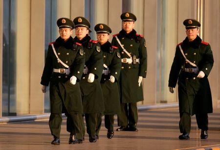 Paramilitary police officers are seen before senior North Korean official Kim Yong Chol's arrival at the international airport for a flight to Washington from Beijing, China January 17, 2019. REUTERS/Jason Lee