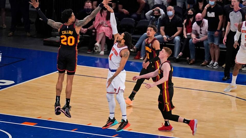 Derrick Rose shoots against Trae Young and Hawks Game 1 2021 playoffs