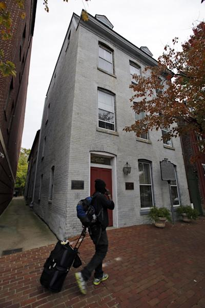 """This photo taken Oct. 31, 2013 shows a person walking past the Freedom House Museum in Alexandria, Va. A small museum across the Potomac River from the nation's capital is connected to the story depicted in the new movie """"12 Years a Slave."""" The Freedom House Museum is at the site where a major slave trader once operated _ the same slave trader who sold Solomon Northrup into slavery after the free man's abduction. The movie is drawing renewed interest from historians and visitors in this Virginia city's role in the slave trade. (AP Photo/Alex Brandon)"""