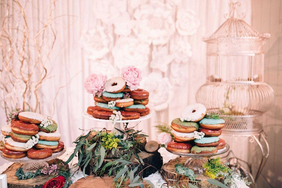 """<p>Not a cake person? Opt for a dessert bar instead. Donuts at weddings are always a good idea, especially when surrounded by florals like these by <a href=""""http://bloominous.com"""" rel=""""nofollow noopener"""" target=""""_blank"""" data-ylk=""""slk:Bloominous"""" class=""""link rapid-noclick-resp"""">Bloominous</a>.<br></p>"""
