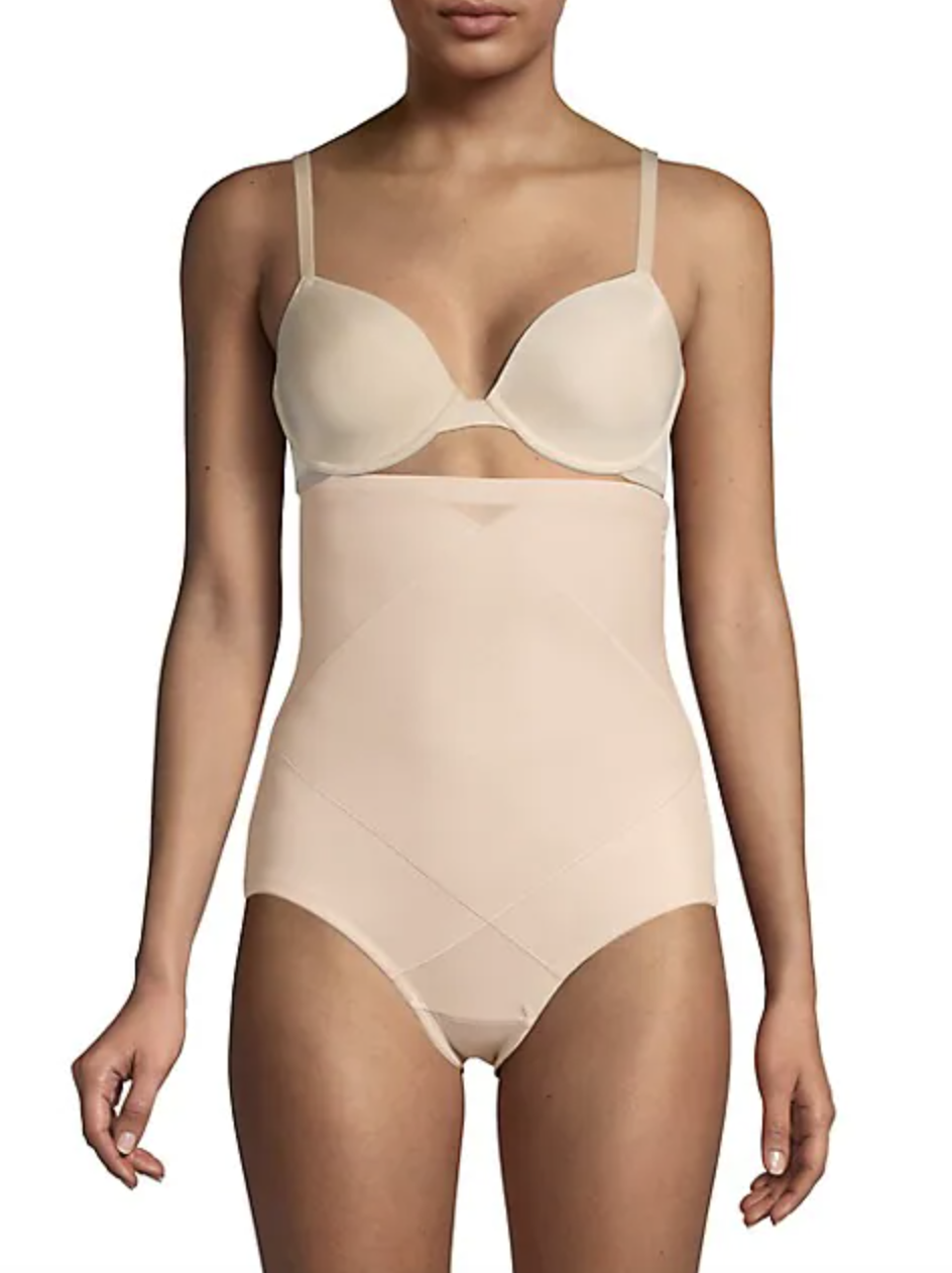 model with her head cut off wearing a beige bra and matching beige high waisted underwear