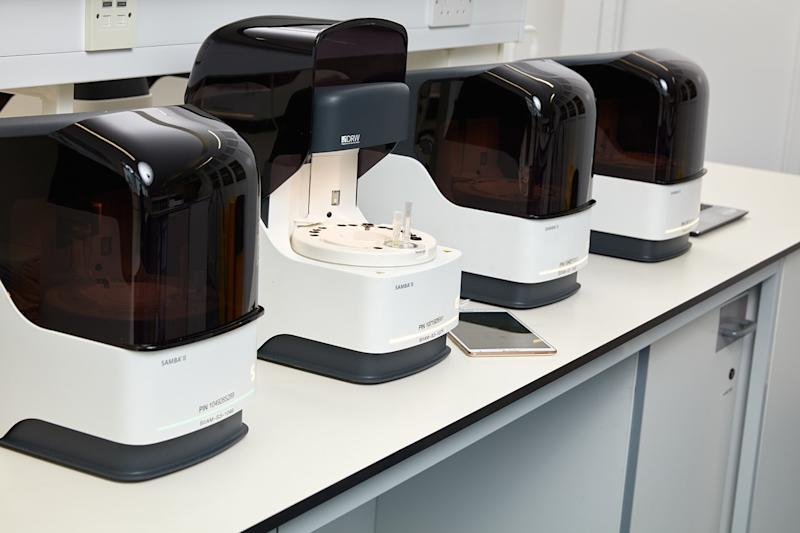 Undated handout photo issued by Cambridge University Hospitals showing SAMBA II testing machines at the NIHR Clinical Research Facility at AddenbrookeÕs Hospital in Cambridge.