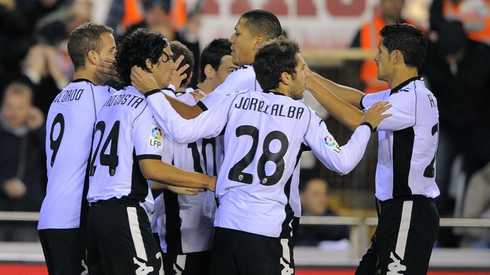Valencia's players celebrate their secon | JOSE JORDAN/Getty Images