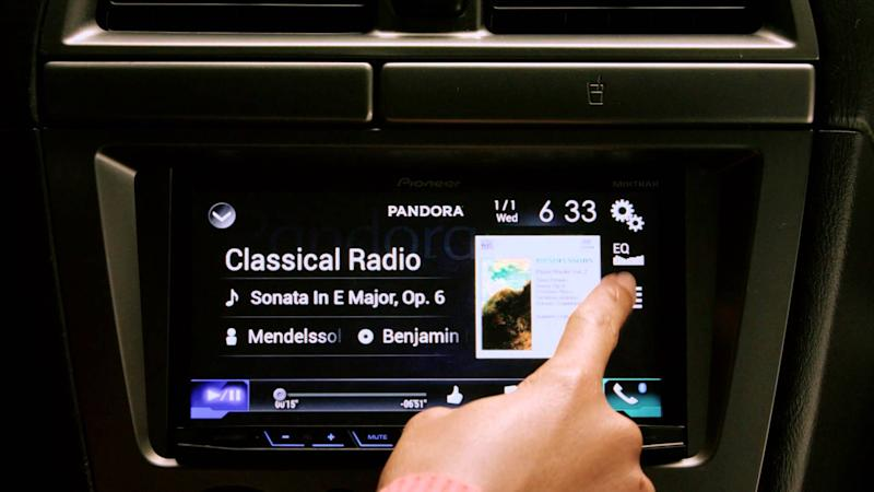 Pandora app streaming on a dashboard touchscreen.