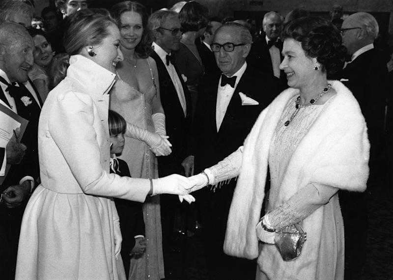 The queen (pictured with Meryl Streep in 1980) will start wearing fake fur. (Photo: Getty)