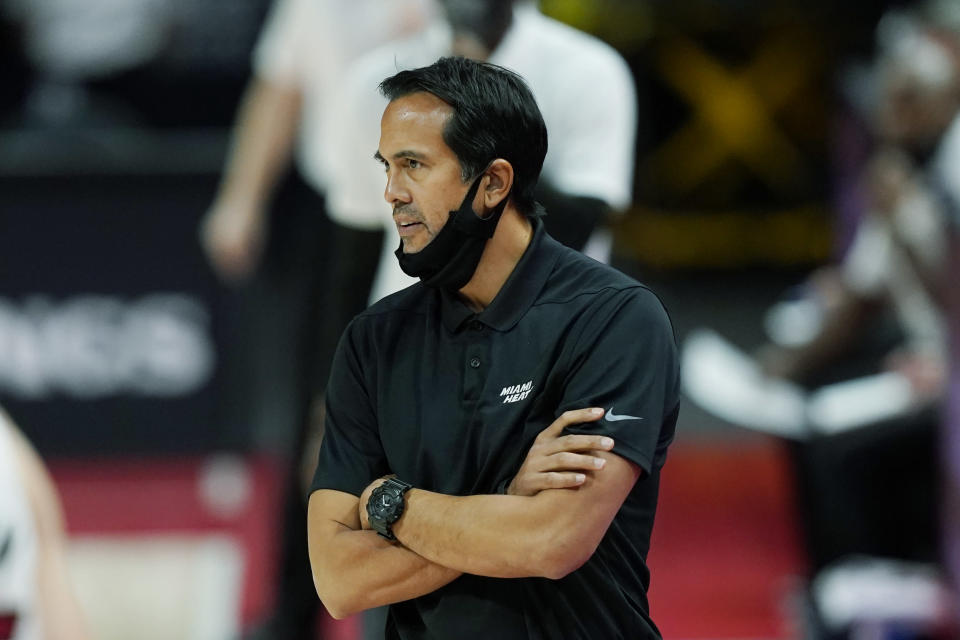 Miami Heat head coach Erik Spoelstra watches from the sideline during the first half of an NBA basketball game against the Detroit Pistons, Sunday, May 16, 2021, in Detroit. (AP Photo/Carlos Osorio)