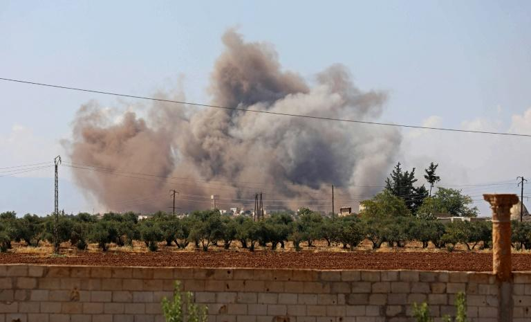 Smoke billows following a bombardment by Syrian government forces around the town of Khan Sheikhun on the southern edges of the rebel-held Idlib province on September 8, 2018