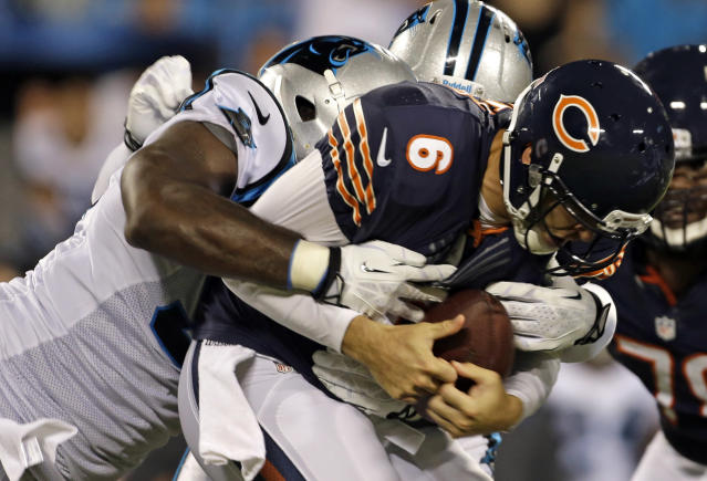 Chicago Bears' Jay Cutler (6) is sacked by Carolina Panthers' Charles Johnson, left, during the first half of a preseason NFL football game in Charlotte, N.C., Friday, Aug. 9, 2013. (AP Photo/Bob Leverone)