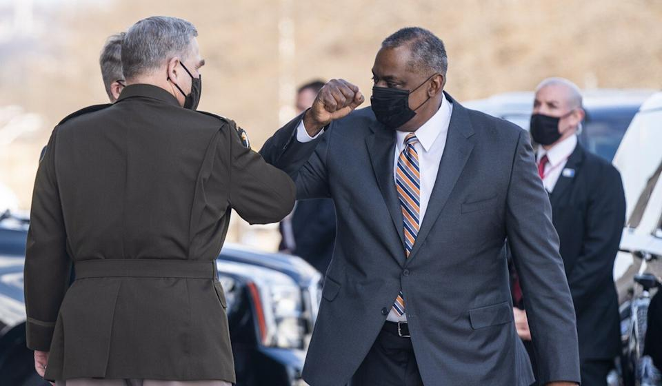 Newly appointed US Defence Secretary Lloyd Austin (right) greets Mark Milley, the chairman of the joint chiefs of staff, as Austin arrives at the Pentagon for his first day on the job. Photo: EPA-EFE