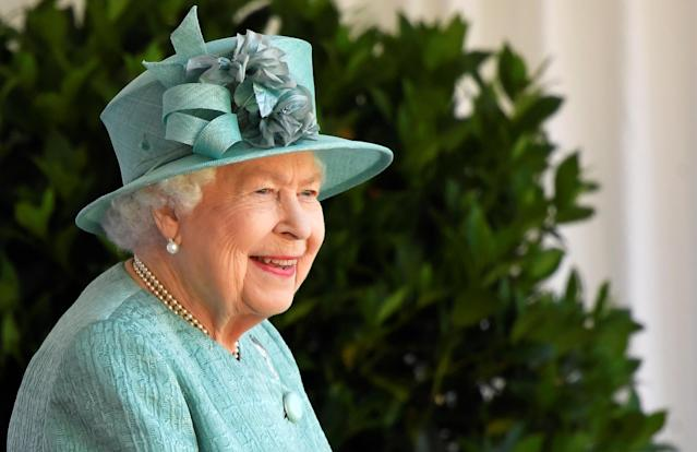 The Queen smiles as she watches the ceremony at Windsor Castle. (Getty Images)