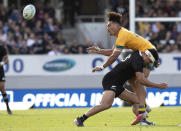 Australia's Jordan Petaia is tackled by New Zealand's Anton Lienert-Brown during the second Bledisloe Rugby test between the All Blacks and the Wallabies at Eden Park in Auckland, New Zealand, Sunday, Oct. 18, 2020. (AP Photo/Mark Baker)