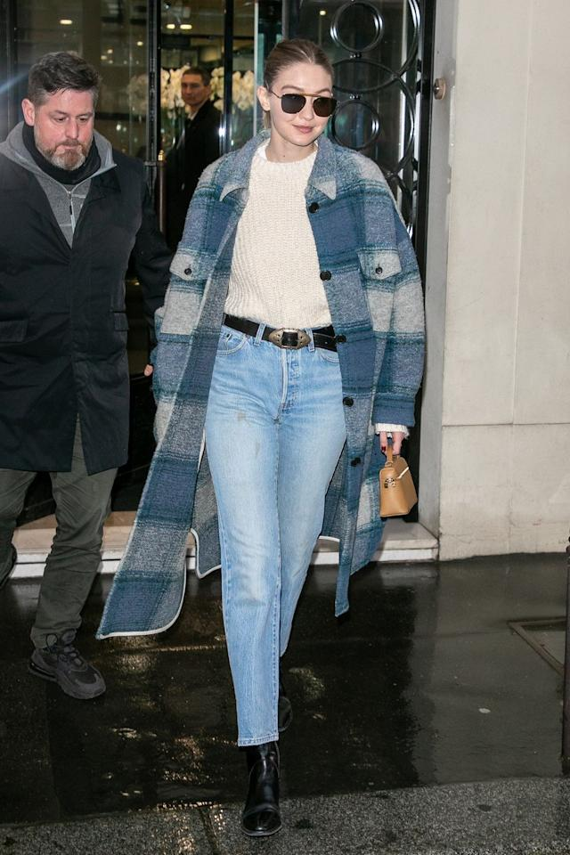 <p>Gigi spotted in Paris in a chic cream sweater paired with mom jeans, she finished off her look with an Isabel Marant coat, Dr Marten boots, and Amavii sunglasses. </p>