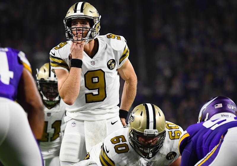 Drew Brees licks his hand while waiting for a snap.