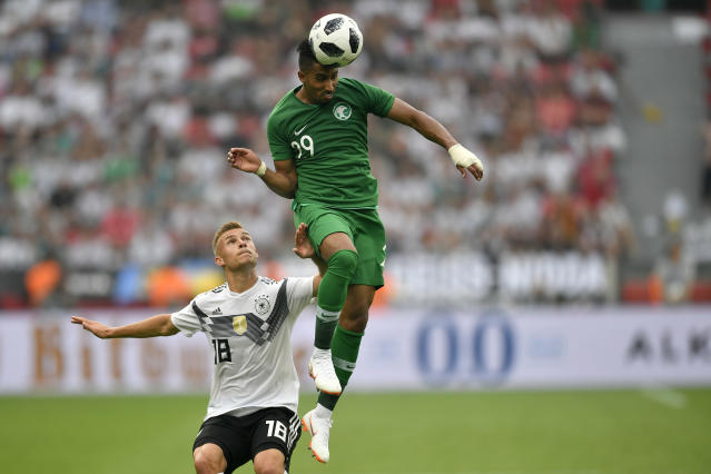 FILE - In this June 8, 2018 fiel photo Saudi Arabia's Salem Al-Dawsari, right, duels for the ball with Germany's Joshua Kimmich during a friendly soccer match between Germany and Saudi Arabia at BayArena in Leverkusen, Germany, in preparation for the 2018 soccer World Cup. (AP Photo/Martin Meissner, file)