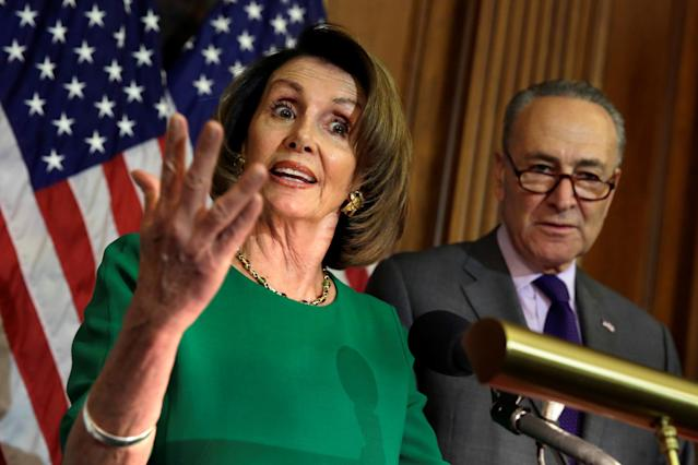 House Minority Leader Nancy Pelosi, D-Calif., speaks next to Senate Minority Leader Chuck Schumer, D-N.Y., during a news conference last April. (Photo: Yuri Gripas/Reuters)
