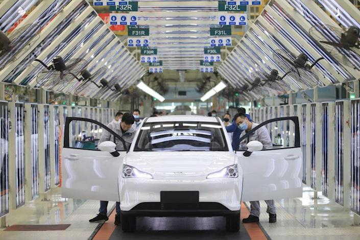 """Employees work on the assembly line of Neta electric car at a factory of Hozon New Energy Automobile Co., Ltd on February 19, 2021 in Jiaxing, Zhejiang Province of China.<span class=""""copyright"""">Cheng Jie/VCG via Getty Images</span>"""