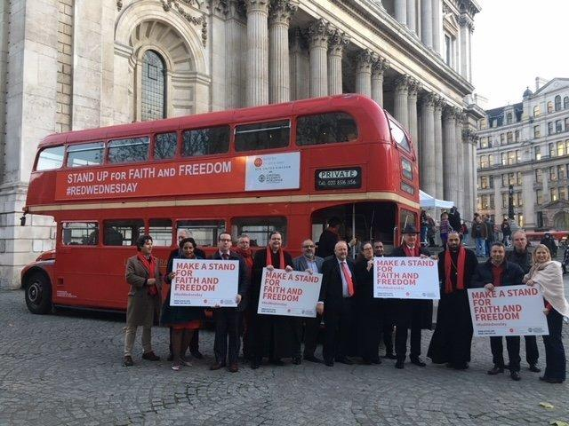Participants attend a #RedWednesday event in central London. (Aid to the Church in Need)