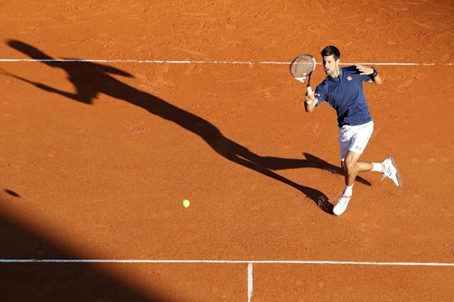 Serbian player Novak Djokovic hits a return to Spain's Pablo Carreno Busta during their Monte-Carlo ATP Masters Series Tournament tennis match, on April 20, 2017 in Monaco (AFP Photo/VALERY HACHE)