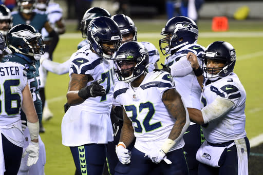 Seattle Seahawks' Chris Carson reacts after scoring a touchdown during the first half of an NFL football game against the Philadelphia Eagles, Monday, Nov. 30, 2020, in Philadelphia. (AP Photo/Derik Hamilton)