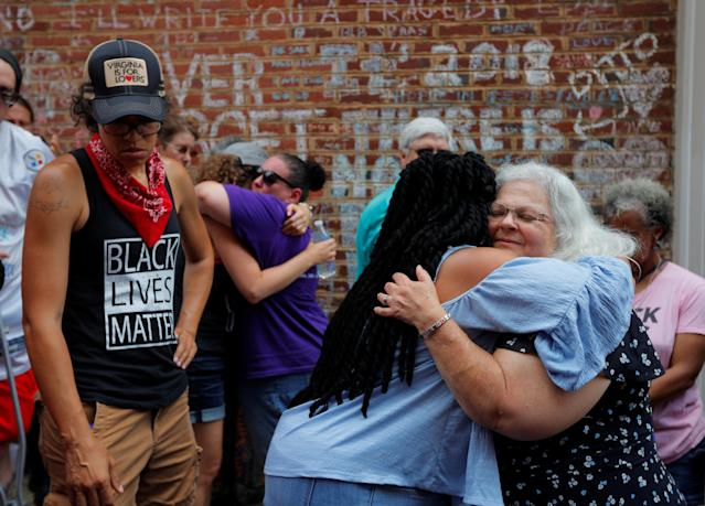 "<p>Susan Bro is embraced at the site where her daughter Heather Heyer was killed, on the one year anniversary of 2017 Charlottesville ""Unite the Right"" protests, in Charlottesville, Virginia, U.S., August 12, 2018. (Photo: Brian Snyder/Reuters) </p>"