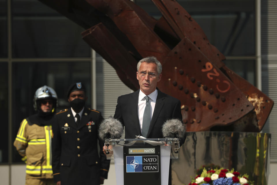 FILE - In this Friday, Sept. 11, 2020 file photo, NATO Secretary General Jens Stoltenberg speaks during a ceremony marking the 19th anniversary of the Sept. 11 attacks, at NATO headquarters in Brussels. NATO Secretary-General Jens Stoltenberg warned Tuesday, Nov. 17, 2020 that the military organization could pay a heavy price for leaving Afghanistan too early, after a U.S. official said President Donald Trump is expected to withdraw a significant number of American troops from the conflict-ravaged country in coming weeks. (AP Photo/Francisco Seco, Pool, File)