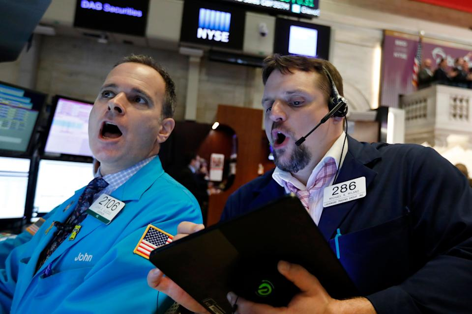 Specialist John Alatzas, left, and trader Michael Milano work on the floor of the New York Stock Exchange, Wednesday, May 1, 2019. Stocks are opening higher on Wall Street after several big U.S. companies reported earnings that were better than analysts were expecting. (AP Photo/Richard Drew)