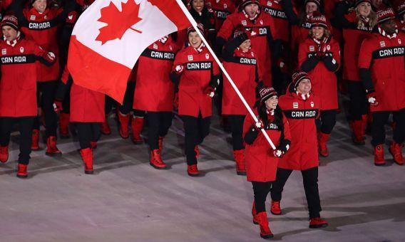 <p>Tessa Virtue and Scott Moir were both Canada's Olympic flag bearers during the Opening Ceremonies. </p>