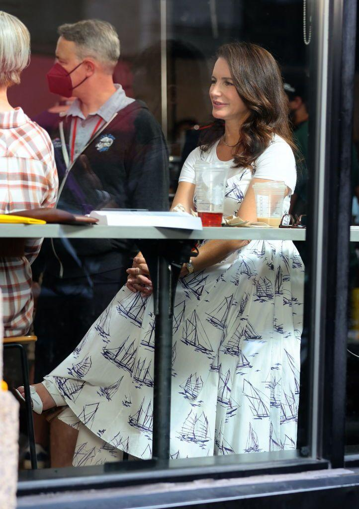 """<p>For a classic lunch scene, Charlotte York wore an appropriate nautical-themed poplin midi dress -worn over a white tee - courtesy of Emilia Wickstead.</p><p><a class=""""link rapid-noclick-resp"""" href=""""https://www.net-a-porter.com/en-gb/shop/product/emilia-wickstead/elita-belted-pleated-printed-poplin-midi-dress/1317377"""" rel=""""nofollow noopener"""" target=""""_blank"""" data-ylk=""""slk:SHOP NOW"""">SHOP NOW</a> Elita belted pleated printed poplin midi dress, £723<br></p>"""