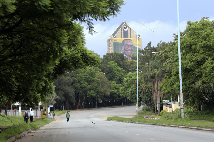 A portrait of Zimbabwean President Emmerson Mnangagwa is seen at the party headquarters during demonstrations over the hike in fuel prices in Harare, Zimbabwe, Tuesday, Jan. 15, 2019. A human rights group in Zimbabwe says five people were killed in clashes between demonstrators protesting fuel hikes and security forces who opened fire on some crowds. (AP Photo/Tsvangirayi Mukwazhi)