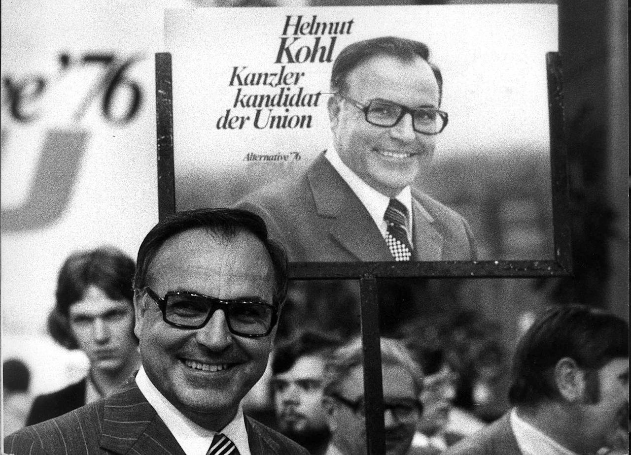 <p>Helmut Kohl stands in front of an election poster during an election campaign for the West German 1976 general election on June. 26, 1975. (Reuters) </p>
