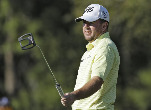 Robert Garrigus reacts as he misses a birdie putt on the 13th hole during the third round of the Valspar Championship golf tournament at Innisbrook Saturday, March 15, 2014, in Palm Harbor, Fla. (AP Photo/Chris O'Meara)
