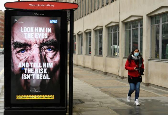 A British government public health information sign is seen on bus shelter in London