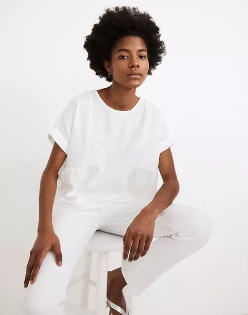 <p>This <span>Madewell Cuffed-Sleeve Shirred Top</span> ($65) is cut from a soft and breathable fabric.</p>
