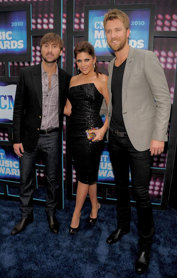 """Hillary Scott glammed it up in a strapless cocktail frock while her Lady Antebellum buddies, Dave Haywood and Charles Kelley, kept it relatively simple in jeans, boots, and blazers. Kevin Mazur/<a href=""""http://www.wireimage.com"""" target=""""new"""">WireImage.com</a> - June 9, 2010"""